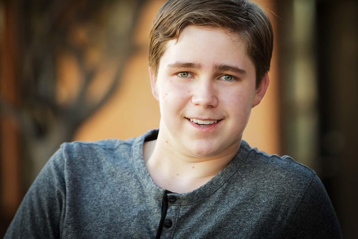 Mesa professional photographer takes portrait of teen boy smiling in Mesa, AZ