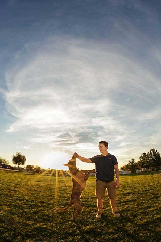 Mesa senior photographer with dog at sunset