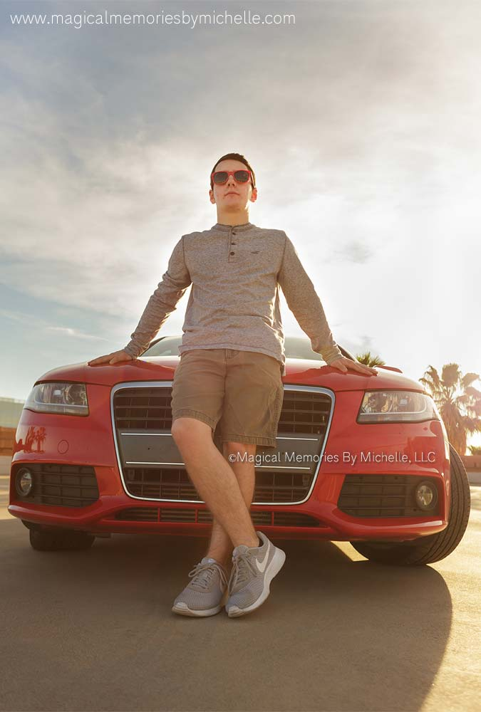 Guy leaning on his car for senior pictures