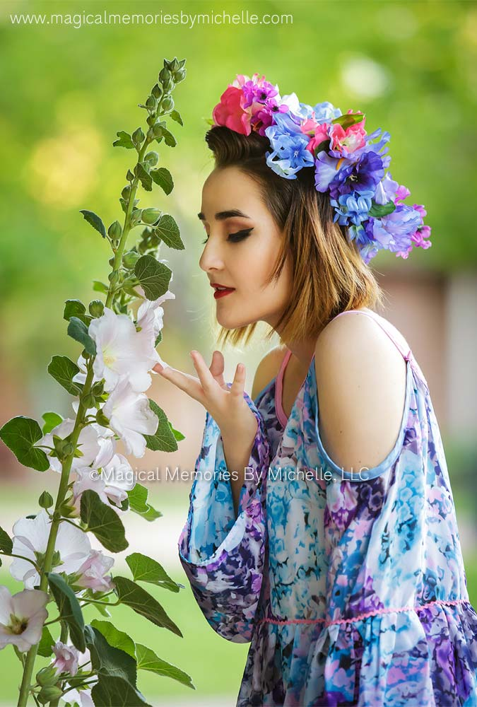 Girl wears handmade floral crown for Phoenix senior pictures.
