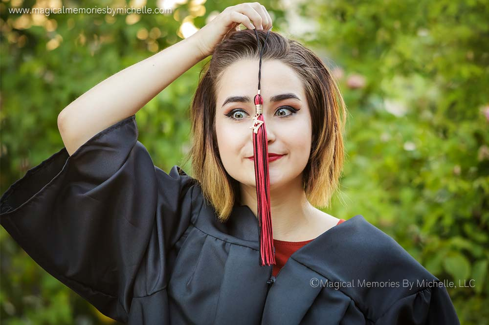 Silly Senior Pictures taken by Phoenix Senior Photographer. Cap & Gown Graduation Pictures with Tassel.